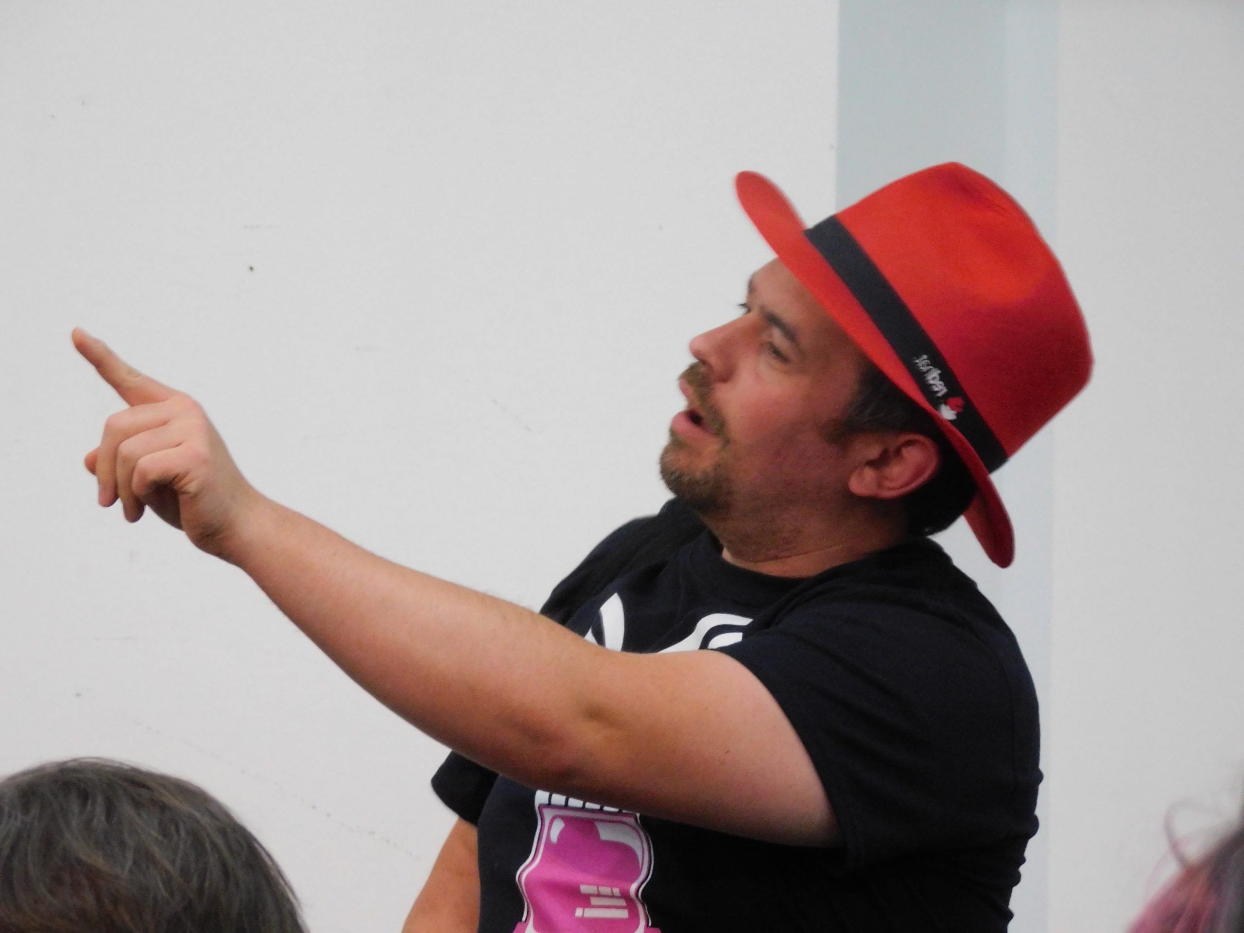 Picture of Jon wearing a Red Hat